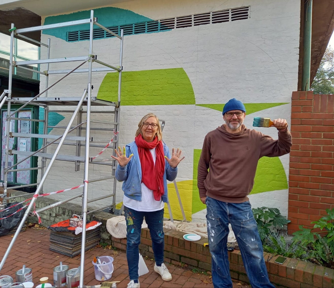 Jo Angell, artist, and her brother painting a new graphic mural at Hornsey Vale